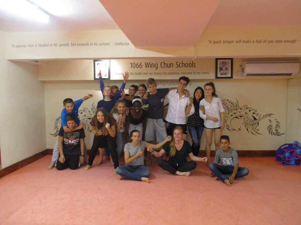 Photo de groupe après une séance d'Arts Martiaux